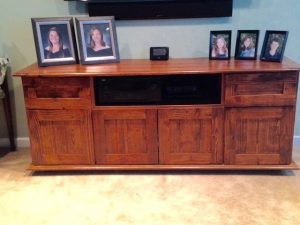 This is an entertainment center cabinet. The outside is all extinct Hart Pine stained and varnished